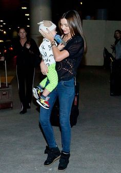 This Is How Trendsetters Style Their Sneakers On the Street, Not the Gym: Miranda Kerr arrived at LAX airport balancing her black high-top Isabel Marant sneakers with a holey top.