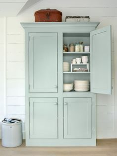 Placed in your dining room, this mint cabinet made to look like a freestanding armoire will make quite the statement, while offering up a creative storage solution for dishes.
