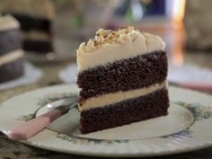 Chocolate and Espresso Layer Cake with Peanut Butter Icing recipe from Damaris Phillips via Food Network