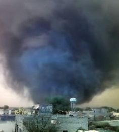 Remarkable, a dark and ominoustornado rolling through a city in northern India in mid-March. Winds whip as the photographer tries to hold the camera steady to capture the large, dusty funnel