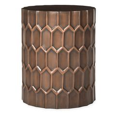 Raised Geometric Details Pair With An Antiqued Copper