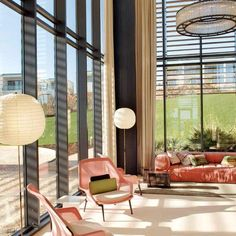 Love high ceilings. The Vitra Slow Chairs bij the Bouroullec brothers are quite nice, too :-)