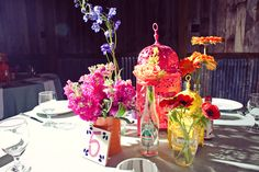 bright fiesta themed wedding re-purposed cans and bottles with lanterns at Vista West Ranch
