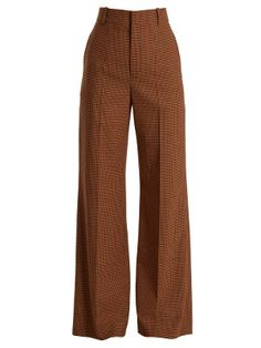 The camel-brown hue and wide-leg silhouette of these Chloé trousers are an overt nod to the 1970s. Crafted from lightweight twill, they're cut to sit high on the waist and fall loosely to the ankles, and are patterned with a tonal-brown and red check design. Style them with a languid blouse and same-tone heels for a particularly sleek look at the office.