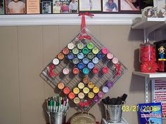 Craft paints stored in two wire racks tied together. Clever.