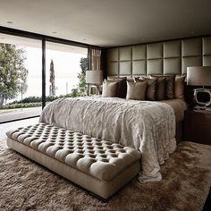 I love the cushion head board that goes all the way to the ceiling