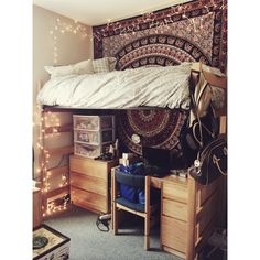 this is all i want in a dorm. light bedding, tapestry, christmas lights.