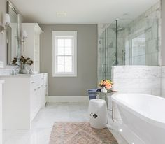 The master bathroom is opulently covered in Carrara marble To add some fun, the designer added an oval penny tile in Carrara as a border Peach Bathroom, Grey Bathrooms, Bathroom Sets, Master Bathroom, Downstairs Bathroom, Floral Shower Curtains, Glass Shower Doors, Luxury Interior Design, Home Staging