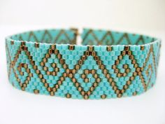 A bracelet pattern made with one drop even peyote stitch using 11/0 Miyuki delica beads in 2 colors. Length: 7.13in (18.1cm) Width: 0.63in (1.6cm)  The PDF file includes:  1. The pattern design 2. A bead legend - bead numbers and colors needed 3. A large, detailed, numbered graph of the pattern. 4. A word chart of the pattern  Please note that instructions for peyote stitch are not included.  *INSTANT DOWNLOADABLE PDF File will be available through Etsy once payment is confirmed.*  The p...