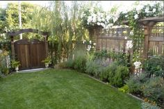 Backyard idea except where the fence is would be the side of my house. Love the gate. #backyard #landscaping