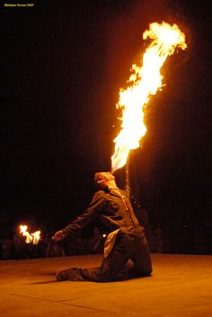 why not add some interesting entertainment to a circus themed wedding - a fire breather