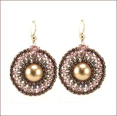 These earring are so beautiful and they remind me of the city lights at night! Enjoy wearing these earring anytime whether it is casual or fancy. The good new is they are quick and easy to make. Made using circular brick stitch, they start with a Swarovski pearl, and then are surrounded with crystals. Japanese seed beads and cylinder beads. The kit comes with everything you need to make a pair of earrings, including sterling silver or gold filled ear wires.They measure 1.5 inches from top of…