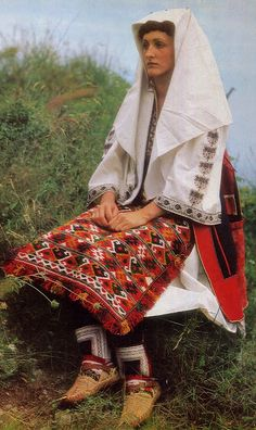 Europe | Portrait of a woman wearing traditional clothes, North Dinaric…