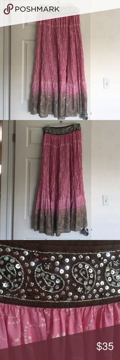 Embellished Silk Maxi Skirt Simply gorgeous! 100% silk skirt. Tag says dry  clean. Sequins and scrolling thread throughout. Meant to be wrinkled/bunched. Top is chocolate brown with silver paisleys of beads and sequins. Perfect boho style. Has adjustable tie inside and invisible zipper on side. Good used condition. Only flaws are hook   is missing from hook and eye closure (not needed tho) and 2 tiny holes near hem. Seen in last picture but not noticeable. Feel free to make a reasonable…