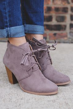 We absolutely adore our Modern Muse Booties so much! These taupe, almond toe ankle booties, constructed with faux suede, tassle laces and zipper, and a stacked wooden heel look amazing with your favor