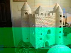 """Farrell Hamann Fine Art.  Video and artworks by Farrell Hamann Fine Art, Sacramento, California. Hand cast, hand carved plaster.  The Palace in this video took months to complete, all with hand tools.  Besides the palace, there is a """"a Castle village, a castle, Towers, and sulpture, some very large works."""