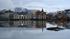 Reykjavik, Iceland  Gorgeous snowy city with view of the Northern lights in the winter, natural hot springs, colorful cottages, stunning landscapes