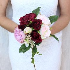Find a wide variety of wedding bouquets and flowers online like this gorgeous, faux rose bouquet in burgundy and mauve. Stunning burgundy roses and soft mauve pink roses create a beautiful contrast of