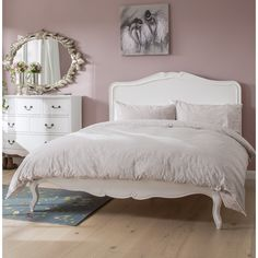 A perfect pink bedroom and shabby chic bed! Bring French charm to your master suite with this elegant bed frame, featuring a curved headboard and neutral hue. With its classically design and antique white finish, this pine wood bed frame is an addition to your country-inspired master suite. Style with ruffled linen bedding, bare wood floorboards and floral fabrics to go all out on the feminine look. aff link for wayfair