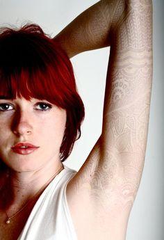 White ink tattoos by Watson Atkinson