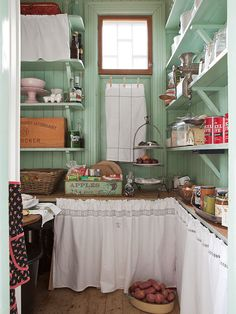 Celadon-green pantry with country laundry instead of cabinet doors. Reminds me of… Celadon-green pantry with country linens in lieu of cabinet doors. Reminds me of the pantry in the triple-decker I lived in as a young married. - Own Kitchen Pantry Cozy Kitchen, Kitchen Pantry, Country Kitchen, Kitchen Decor, Kitchen Design, Kitchen Ideas, Green Kitchen, Kitchen Walls, Kitchen Rustic