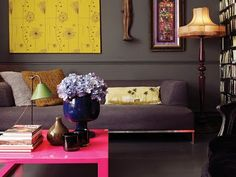bright furniture and wall art against dark wall color, great look for the living room