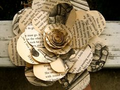 Oversized vintage book paper flower: home decor, gift topper, accessory, hair clip, brooch pin, wedding, winter, spring. $10.00, via Etsy.