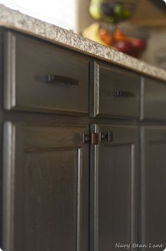 shouse. gray cabinet stain so you can see wood grain. countertop color.