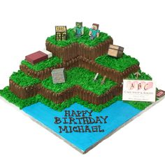 Minecraft cake with Steve, Zombi, wooden & stone sword, bed, gold block, crafting table, pickaxe, chest.  Resembling the crafting of land blocks in the game.