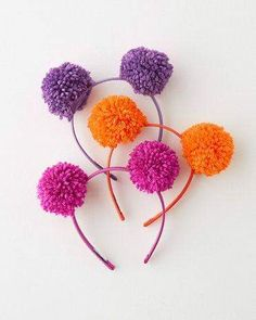 Adorned with voluminous pom-poms, this is a head-topping accessory with head-turning appeal! Adorned with voluminous pom-poms, this is a head-topping accessory with head-turning appeal! Pom Poms, Pom Pom Headband, Diy Headband, Headbands, Pom Pom Crafts, Yarn Crafts, Diy And Crafts, Crafts For Kids, Beaded Crafts