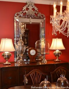 BNOTHP used a fancy mirror with the fancy chandelier.  Its got some distraction so people don't look in it and it goes to the ceiling though perhaps the ceiling isn't as high.   Dining Room Venetian Glass Mirror