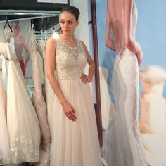 A beautiful beaded blush gown by Kitty Chen Couture