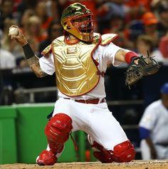 "Yadier Molina wore the flashiest gold catcher's gear and Twitter had jokes  -  July 11, 2017  -  ""Tony Stark: I am Iron Man   Yadier Molina: Hold my beer   #ASG"""