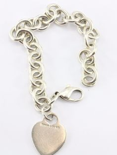Tiffany & Co Sterling Silver Heart Tag Bracelet. The piece is in great used…