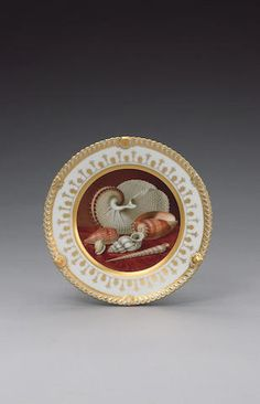 An important Chamberlain cabinet plate by Thomas Baxter circa 1820 in the 'Regent' body with gadroon and shell moulding around the rim picked out in gold, the cavetto fully painted by Thomas Baxter with an arrangement of shells on a richly grained wooden tabletop, surrounded by a black line, wider gilt band and a neoclassical border,  Footnotes An almost identical composition of shells by Thomas Baxter is seen on the famous Swansea plate illustrated by John O Wilstead and Bernard Morris…