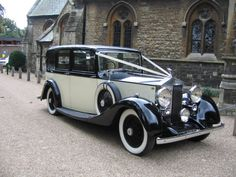 Wanstead-based Elegance Wedding Cars. Photographed outside Christ Church.
