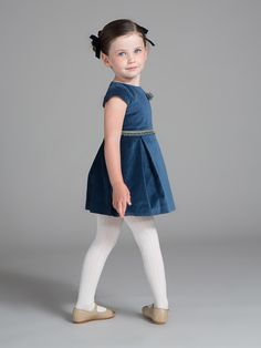 Velour Winter Wonderland Outfit Girls' regal blue princess pleated dress with mint and blue boucle corsage and waist trim Designed by: Fina Ejerique Made in Spain