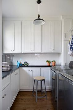 Farmhouse laundry room with shaker style cabinet. Farmhouse laundry room with…
