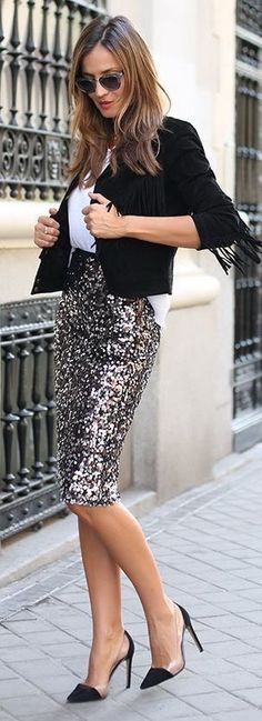 Black jacket over white blouse with cute silver metallic pencil skirt.