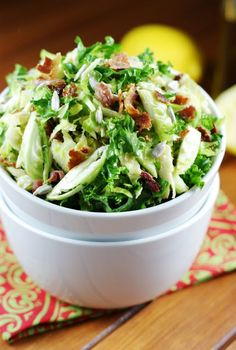 Shredded Brussels Sprouts Salad ~ thinly sliced fresh Brussels sprouts and kale with maple vinaigrette make for one surprisingly fabulous salad.   www.thekitchenismyplayground.com