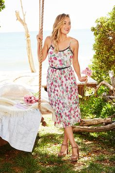 Swing into the season of al fresco fetes in a pretty midi dress. With black lace accents and a bright floral print, this sundress works for garden parties and outdoor weddings alike. Find this LC Lauren Conrad look only at Kohl's.