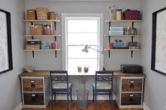 two-person desk built from filing cabinet bases with a wood desktop