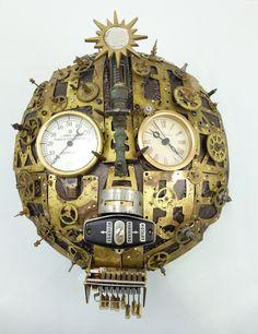 Assemblique.com mask sculptures using antique clock and sewing machine parts