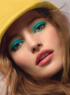 Turquoise eyes and coral lips.