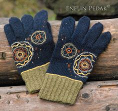 Mulgi gloves -Some cool wool images:  Mulgi gloves    Image by amountofcoffee  Mulgi Gloves are embellished with embroidery. Embroidery is inspired of Viljandi county hip-aprons from Estonia in 18.century.    The Mulgi gloves got a special prize in E