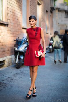 red dress with statement clutch