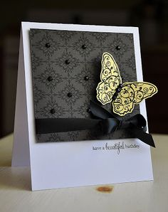 handmade card from Simply Stamped: Embellish Color Challenge with a Stamped Background ... created background stamping black on deep gray and then adding enamel dots ...  flourishes butterfly stamped black on yellow and embellished with black rhinestones ... elegantly delightful!