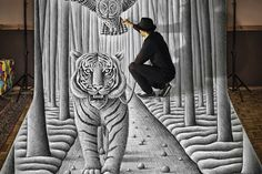 Here is something very special. Renowned digital artist Ben Heines, who specializes in 3-D drawing techniques, has gifted us with a masterclass in transforming a simple pencil drawing into a magical 3-D experience. In these images a tiger is brought to life in various stages, before creating a self portrait in the same way. All.... http://illusion.scene360.com/art/59192/3-d-tiger-comes-to-life/