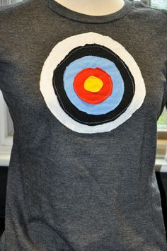 This is a great fun shirt that should be a part of every wardrobe!  Throw it on under a cardigan and it's awesome .... Archery Target Tshirt by poepindesigns on Etsy, $25.00