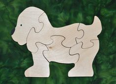 """This Puppy Puzzle is fun to do and assists in the development of small motor, hand-eye coordination, visualization and problem solving skills all of which are important in the process of reading. Our puzzles are made from toy quality 1/2"""" Baltic birch plywood and are rubbed with AMF Naturals, an oil wax finish that is completely safe. Dimensions: 7"""" high, 9"""" long"""